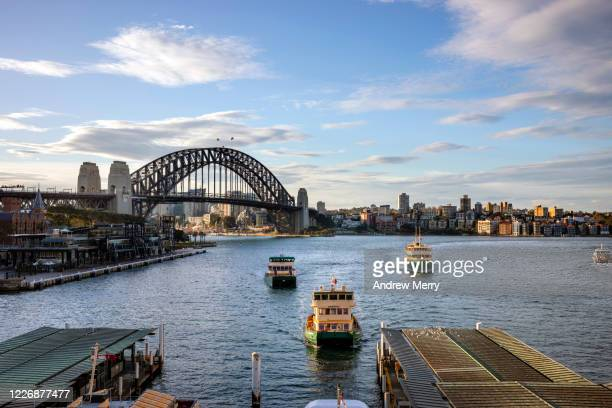 sydney harbour bridge and circular quay ferry wharf, australia - sydney stock pictures, royalty-free photos & images