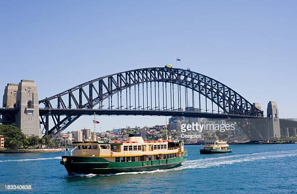 sydney harbour bridge and city skyline in australia - ferry stock photos and pictures