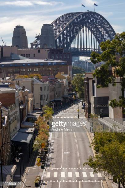 sydney harbour bridge and empty city street during coronavirus pandemic, australia - sydney stock pictures, royalty-free photos & images