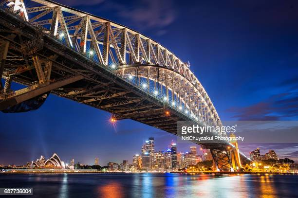 sydney harbour bridge and skyline at nigh - sydney harbour bridge stock pictures, royalty-free photos & images