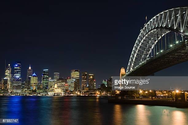 Sydney harbour bridge and skyline at night