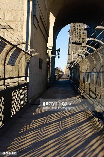 sydney harbour bridge fence casting long shadows - sydney ストックフォトと画像