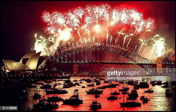 Sydney Harbour Bridge is illuminated by a New Year's Eve fireworks display 31 December which police and organisers used as a rehearsal for the Sydney...