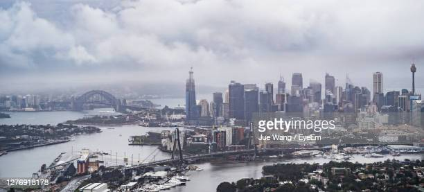 sydney harbour bridge over paramatta river with cbd in background - wang he stock pictures, royalty-free photos & images