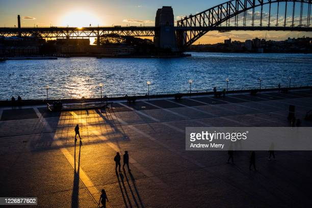 sydney harbour bridge, view across circular quay during coronavirus pandemic, australia - new south wales stock pictures, royalty-free photos & images