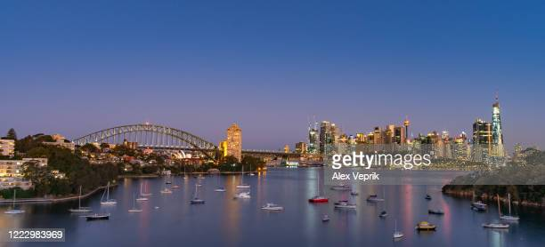 sydney harbour in distance - sydney stock pictures, royalty-free photos & images