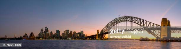 sydney harbour sunset panoramic - wonderlust stock photos and pictures