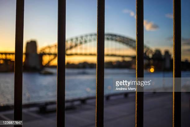 sydney in lockdown with sydney harbour bridge, coronavirus, covid-19 pandemic, australia - forbidden stock pictures, royalty-free photos & images