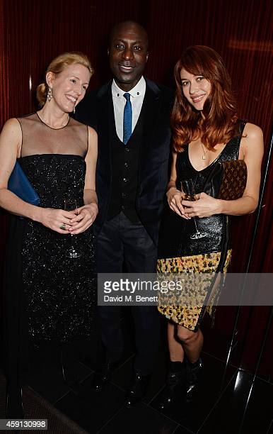 Sydney Ingle Finch Ozwald Boateng and Olga Kurylenko attend the Liberatum Cultural Honour for Francis Ford Coppola at The Bulgari Hotel on November...
