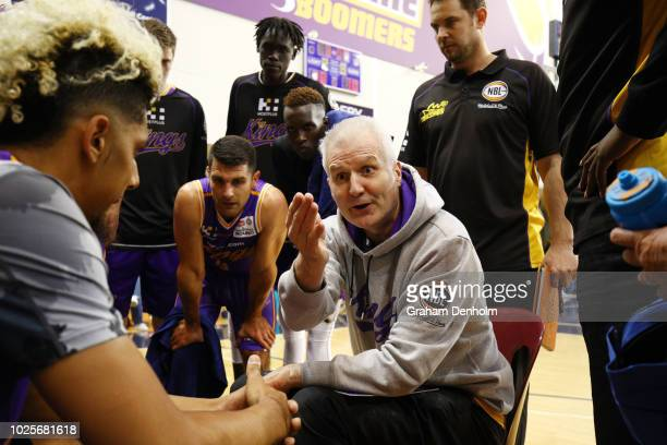 Sydney Kings Head Coach Andrew Gaze talks to his players during the NBL preseason match between Melbourne United and the Sydney Kings at State...
