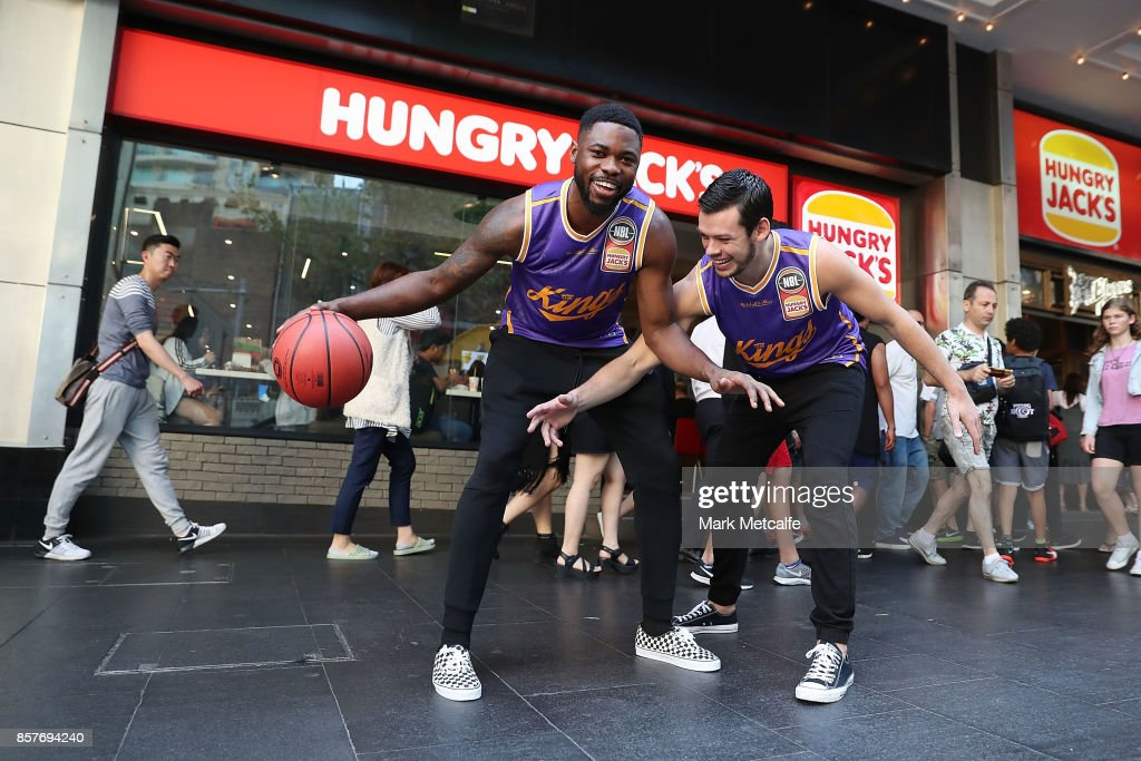 Sydney Kings players Travis Leslie and Jason Cadee pose during the NBL Hungry Jacks sponsorship announcement at the George Street Hungry Jacks on October 5, 2017 in Sydney, Australia.