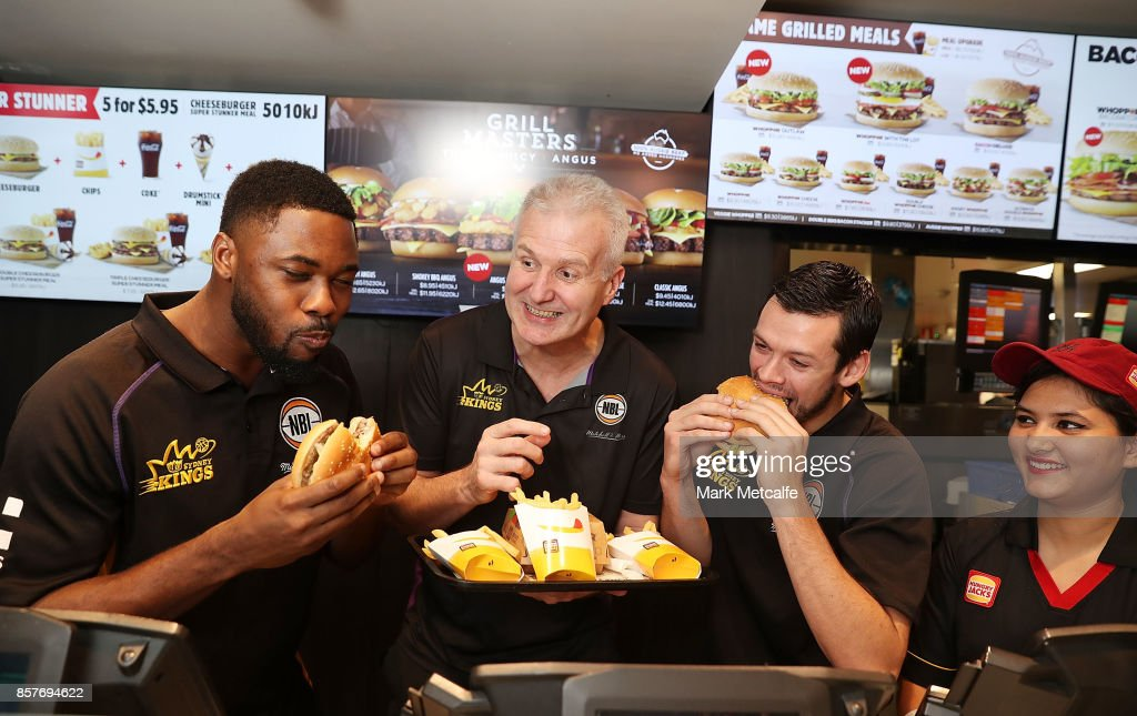 Sydney Kings players Travis Leslie and Jason Cadee pose with head coach Andrew Gaze during the NBL Hungry Jacks sponsorship announcement at the George Street Hungry Jacks on October 5, 2017 in Sydney, Australia.