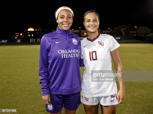 Sydney Leroux of the Orlando Pride pose with Deyna Castellanos of the Florida State Seminoles after a preseason match at the Seminole Soccer Complex...