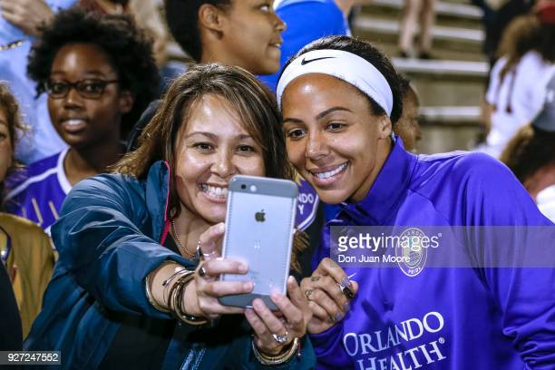 Sydney Leroux of the Orlando Pride take a selfie with a fan after a preseason match against the Florida State Seminoles at the Seminole Soccer...