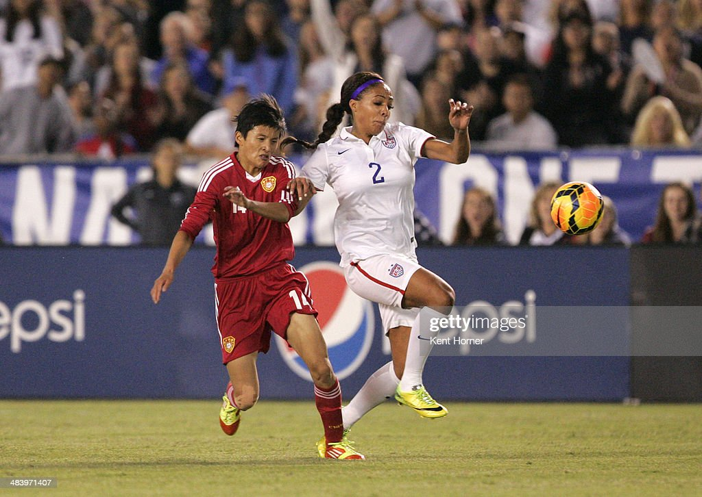 Sydney Leroux #2 of the United States dribbles the ball in the first half of the game against Wang Shanshan #14 of China during an international firendly match at Qualcomm Stadium on April 10, 2014 in San Diego, California.