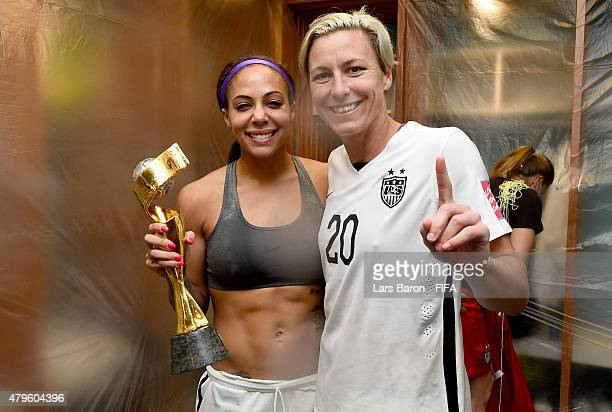 Sydney Leroux of USA and Abby Wambach of USA pose with the trophy in the locker room after winning the FIFA Women's World Cup 2015 Final between USA...