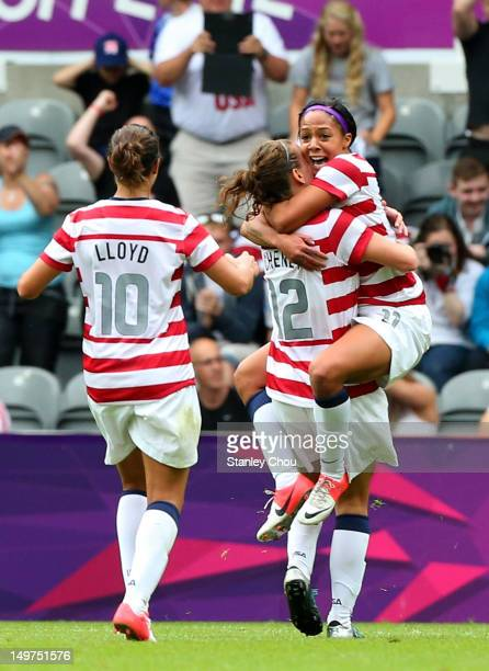 Sydney Leroux of USA celebrates with Lauren Cheney and Carli Lloyd after scoring against New Zealand during the Women's Football Quarter Final match...