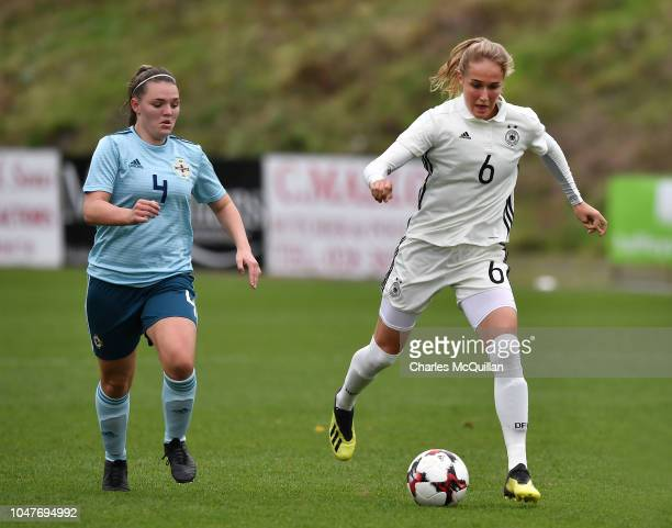 Sydney Lohmann of Germany and Abbie Magee of Northern Ireland during the UEFA Women's Under 19 Group 9 Euro Qualifier at Shamrock Park between...