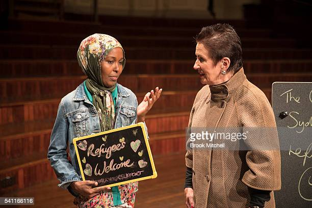 Sydney Lord Mayor Clover Moore and Maria Salad show support for refugees on June 19 2016 in Sydney Australia The rally was organised as a show of...