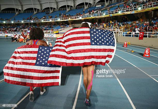 Sydney McLaughlin and Brandee Johnson of the USA celebrate with flags after the Girls 400 Meters Hurdles Final on day four of the IAAF World Youth...