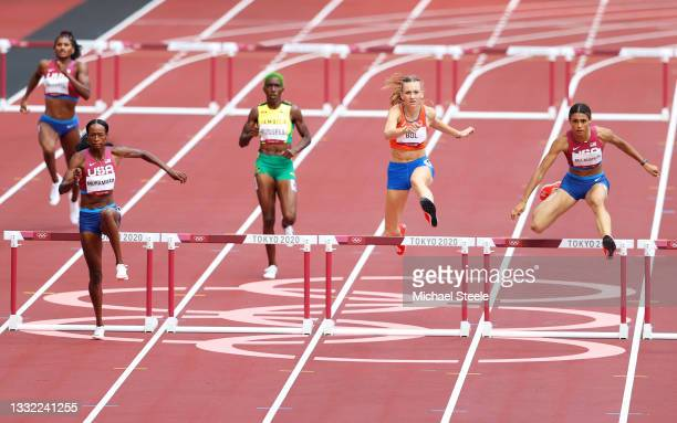 Sydney McLaughlin of Team United States wins the gold medal ahead of Dalilah Muhammad of Team United States in the Women's 400m Hurdles Final on day...