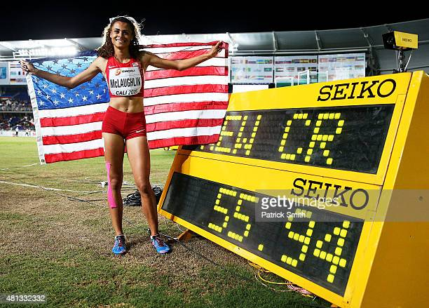 Sydney McLaughlin of the USA celebrates with a flag after the Girls 400 Meters Hurdles Final on day four of the IAAF World Youth Championships Cali...