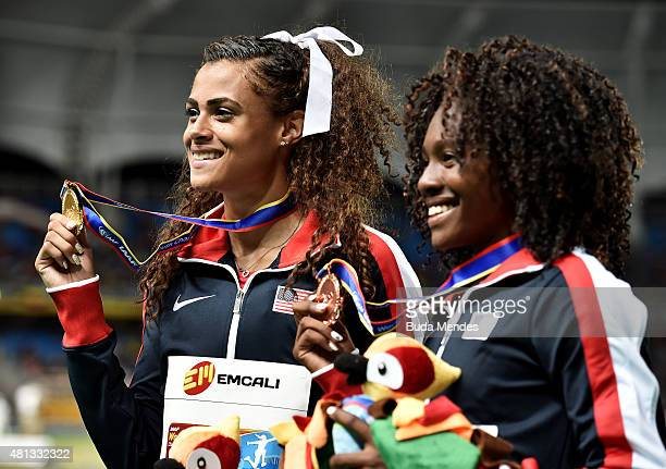 Sydney McLaughlin of the USA gold medal and Brandee Johnson of the USA bronze medal celebrate on the podium after the Girls 400 Meters Hurdles Final...