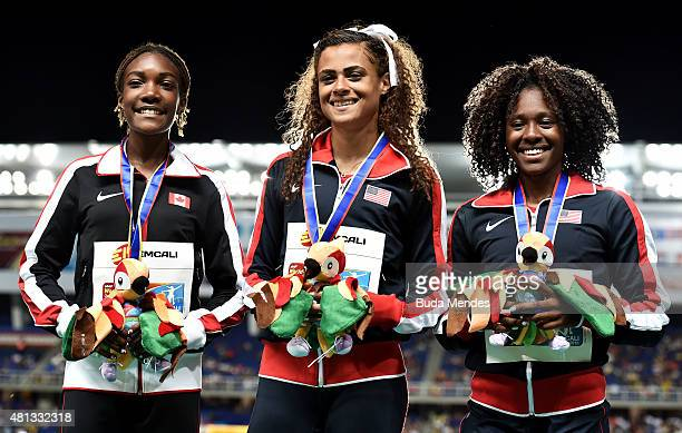 Sydney McLaughlin of the USA gold medal Xahria Santiago of Canada silver medal and Brandee Johnson of the USA bronze medal celebrate on the podium...