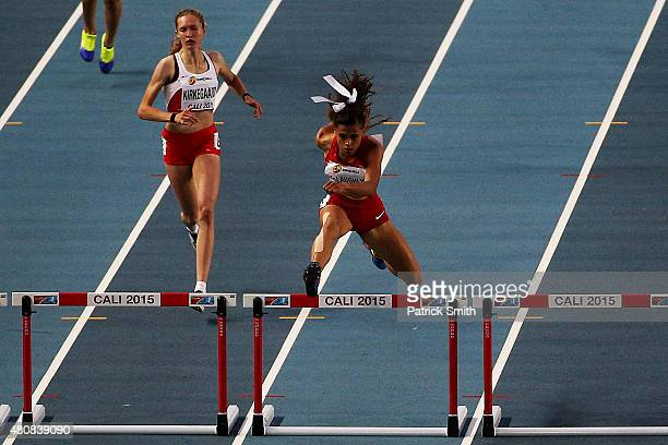 Sydney McLaughlin of the USA leads Anne Sofie Kirkegaard of Denmark during round one of the Girls 400 Meters Hurdles on day one of the IAAF World...