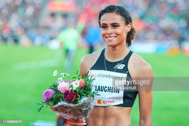 US Sydney Mclaughlin poses with flowers after winning Women`s 400m hurdles during the IAAF Athletics Diamond League competition on June 13 2019 at...