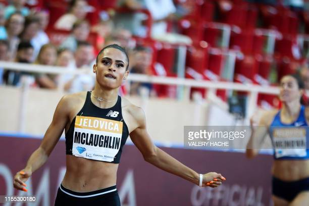 Sydney McLaughlin reacts as she crosses the finish line and wins the Women's 400m hurdles during the IAAF Diamond League competition on July 12, 2019...