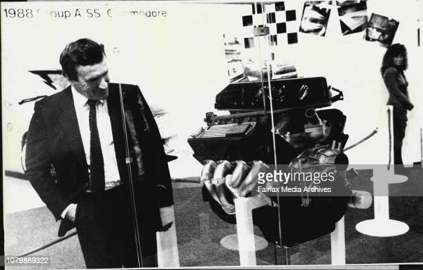 Sydney Motor Show New Holden engine for 1988 A SS Commodore was unveiled by Tom Walkinshaw who is watching what Tom the engine the model on right...