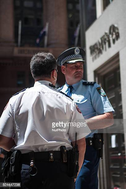 Office workers are evacuated from a building as parts of Sydney's central business district remain closed following a hostage incident on December 15...
