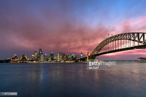 sydney opera house and harbor bridge, sydney, australia (sunset) - sydney ストックフォトと画像