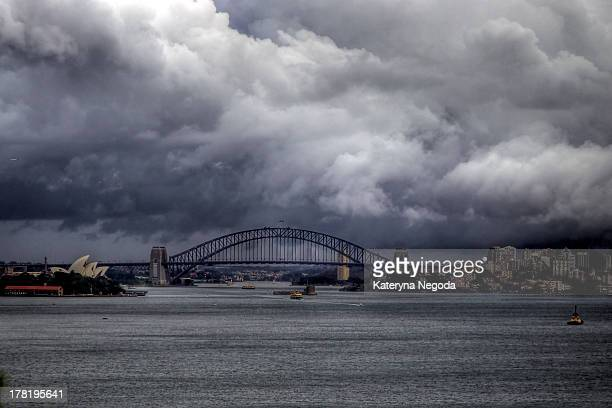 Sydney Opera House and Harbour Bridge. The Sydney Harbour Bridge is a steel through arch bridge across Sydney Harbour that carries rail, vehicular,...