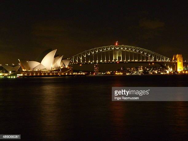 CONTENT] Sydney Opera House and Sydney Habour Bridge at night time darkness Iconic building Australia