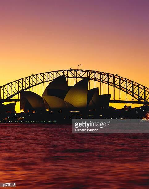 sydney opera house and sydney harbour bridge at sunset, sydney, australia - travel14 stock pictures, royalty-free photos & images