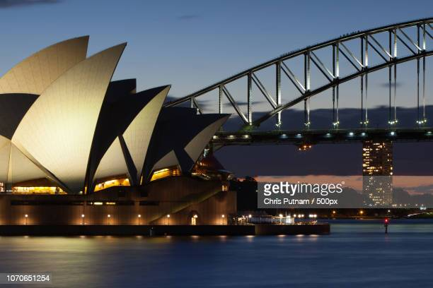 sydney opera house at dusk - chris putnam stock pictures, royalty-free photos & images