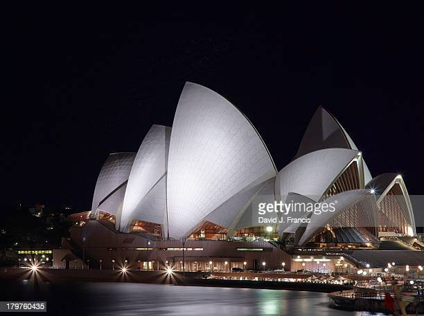 Sydney Opera House at night as viewed from the elevated platform at Circular Quay metro station.