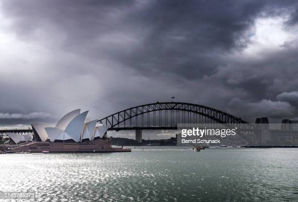 sydney opera house & harbor bridge - bernd schunack stock photos and pictures