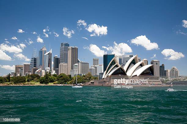 sydney opera house in sydney harbor with downtown skyline, sydney, new south wales, australia - sydney stock pictures, royalty-free photos & images