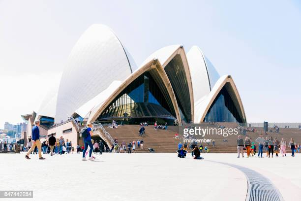 Sydney Opera House surrounded with people in sunny afternoon