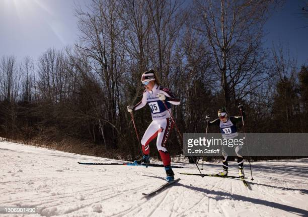 Sydney Palmer-Leger of the University of Utah and Molly Miller of Northern Michigan University during the women's 15km freestyle at the NCAA Skiing...