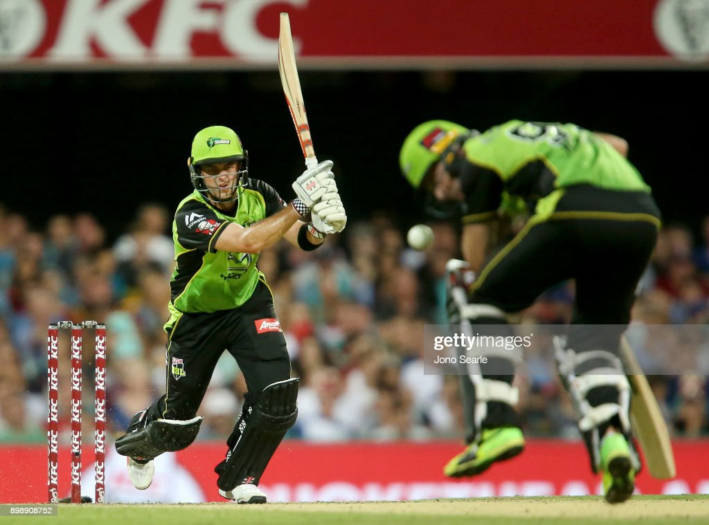 Sydney player Callum Ferguson (left) accidentally hits team mate Ben Rohrer (right) with his shot during the Big Bash League match between the Brisbane Heat and the Sydney Thunder at The Gabba on December 27, 2017 in Brisbane, Australia.