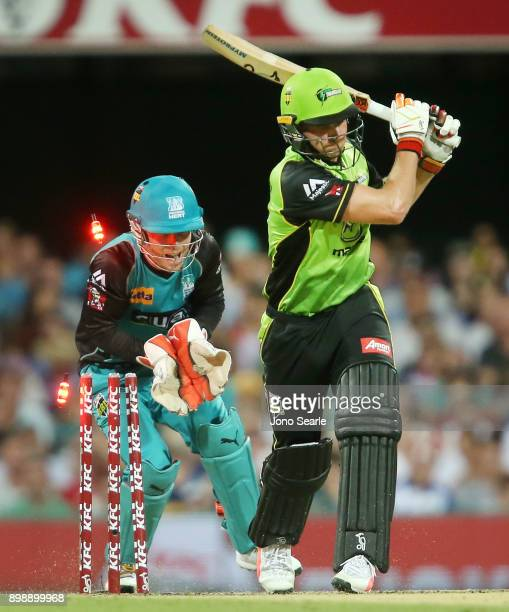Sydney player Jos Butler is bowled out as Brisbane player Jimmy Peirson celebrates during the Big Bash League match between the Brisbane Heat and the...