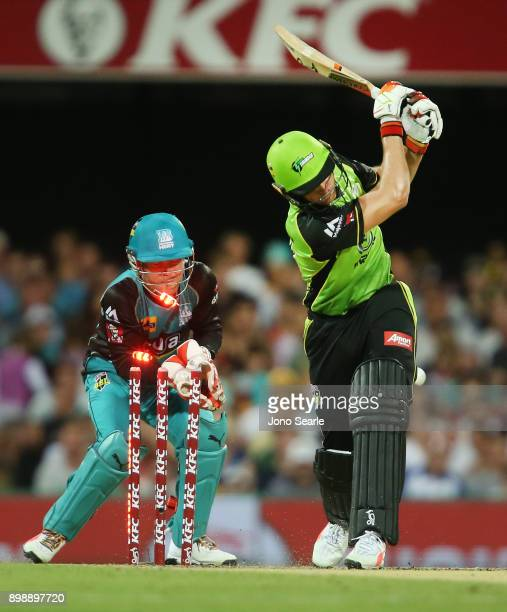 Sydney player Jos Butler is bowled out during the Big Bash League match between the Brisbane Heat and the Sydney Thunder at The Gabba on December 27...