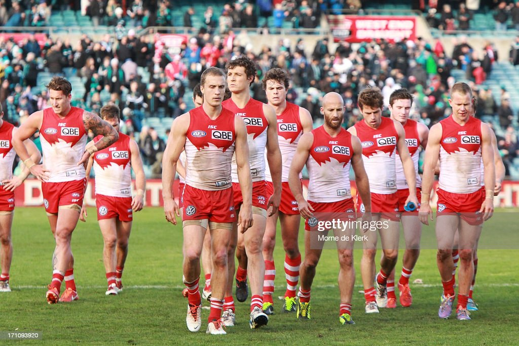 Sydney players come from the field after the round 13 AFL match between Port Adelaide Power and the Sydney Swans at AAMI Stadium on June 22, 2013 in Adelaide, Australia.