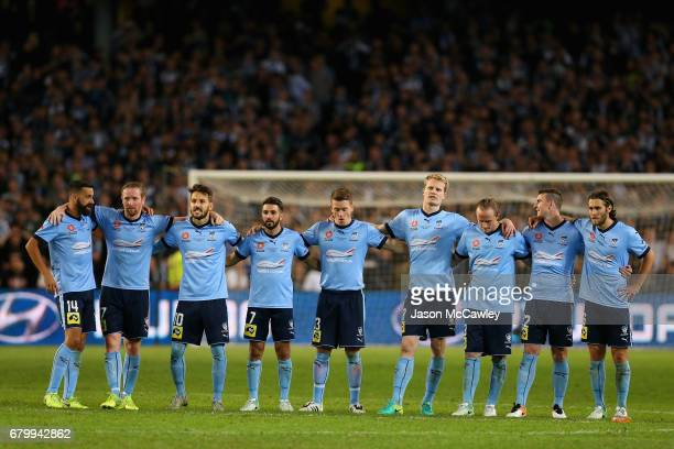 Sydney players look on during the penalty shoot out during the 2017 ALeague Grand Final match between Sydney FC and the Melbourne Victory at Allianz...
