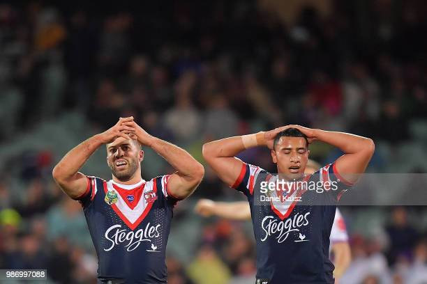 Sydney Roosters players look on dejected during the round 16 NRL match between the Sydney Roosters and the Melbourne Storm at Adelaide Oval on June...