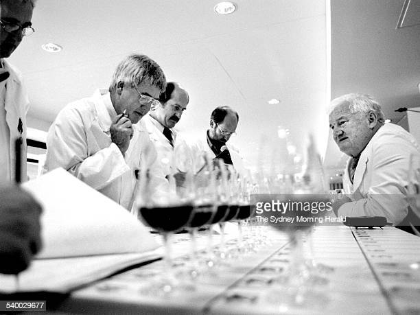Sydney Royal Wine Show chairman of judges Len Evans right talks to fellow judges as they prepare to begin tasting at Homebush Bay 7 February 2000 SMH...